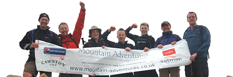 Jubilant 3 Peaks Team celebrate a speedy ascent of Scafell Pike - one more to go!